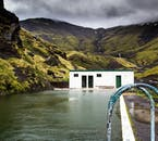 Seljalandslaug is a pool that is located on the south coast and is filled by the warm water that drips from the adjacent mountain.