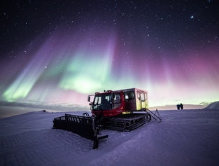 Hunting Northern Lights by Snowcat on Múlakolla Mountain