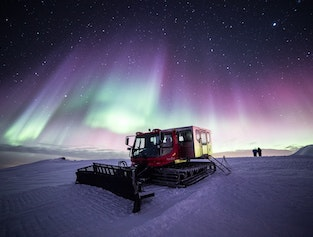 Hunting Northern Lights by Snowcat on Múlakolla Mountain