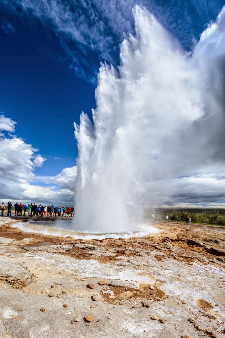 Strokkur geyser regularly erupts to heights exceeding twenty metres.