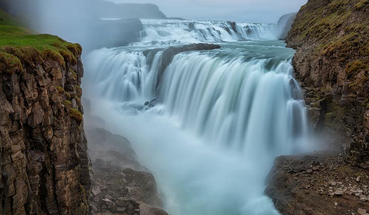 Hear the thundering noises of Gullfoss waterfall as water tumbles down 32-metres into an ancient canyon