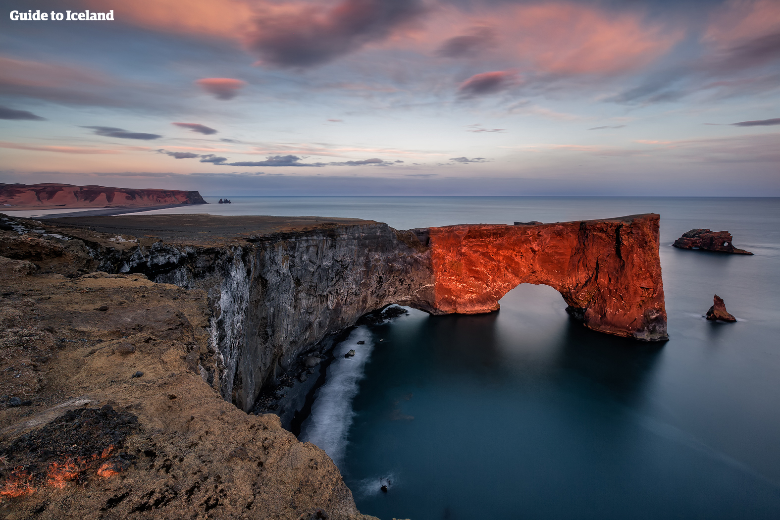 Dyrhólaey is an enormous stone arch that extends into the sea off South Iceland's coast.