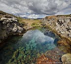 The crystal clear waters in Þingvellir's ravines originates from Langjökull glacier.