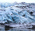 The glaciers of Iceland in winter appear to wear an armour of blue ice.