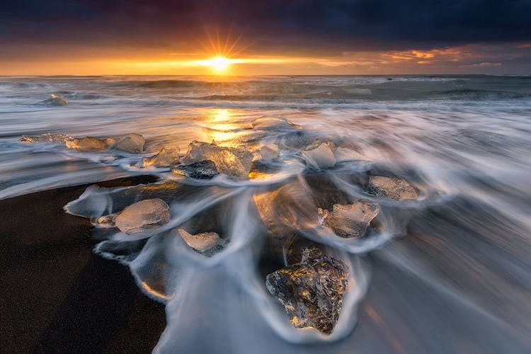 The dim sunlight brings out the beauty of the Diamond Beach in South Iceland in winter.