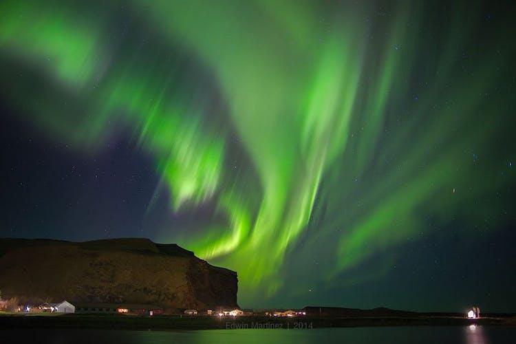 The Northern Lights dancing above the South Iceland village of Vík í Mýrdal.