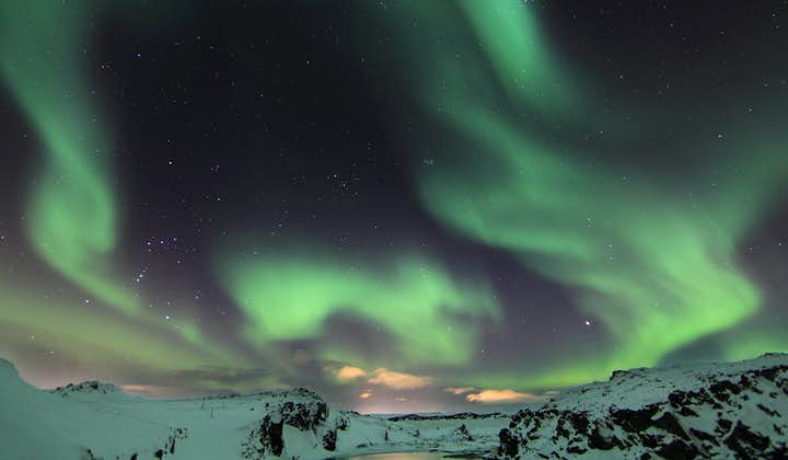 The Northern Lights only appear during the wintertime, illuminating the beautiful, yet frostbitten landscape.