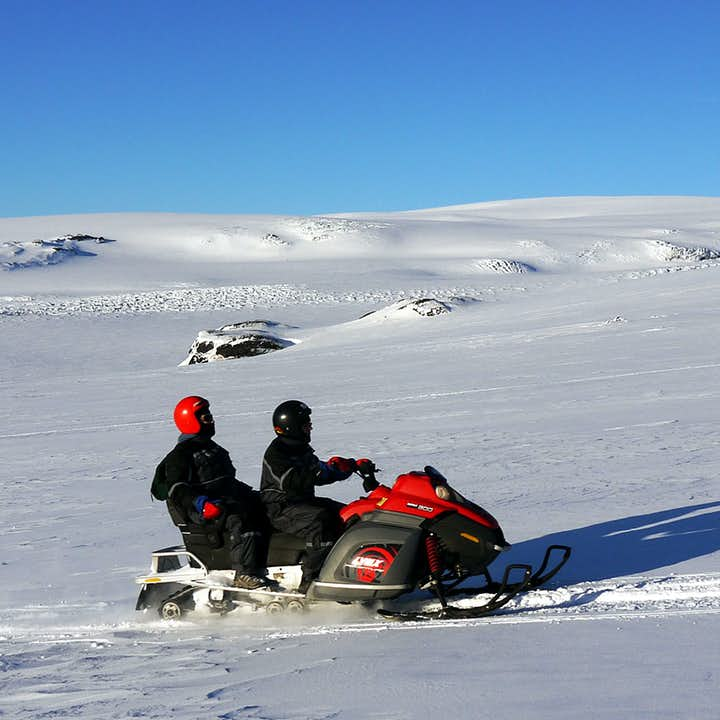 Riding a snowmobile in pairs is an incredibly bonding experience.