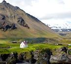 On a minibus tour of Snæfellsnes Peninsula, you'll visit the small hamlet of Arnarstapi