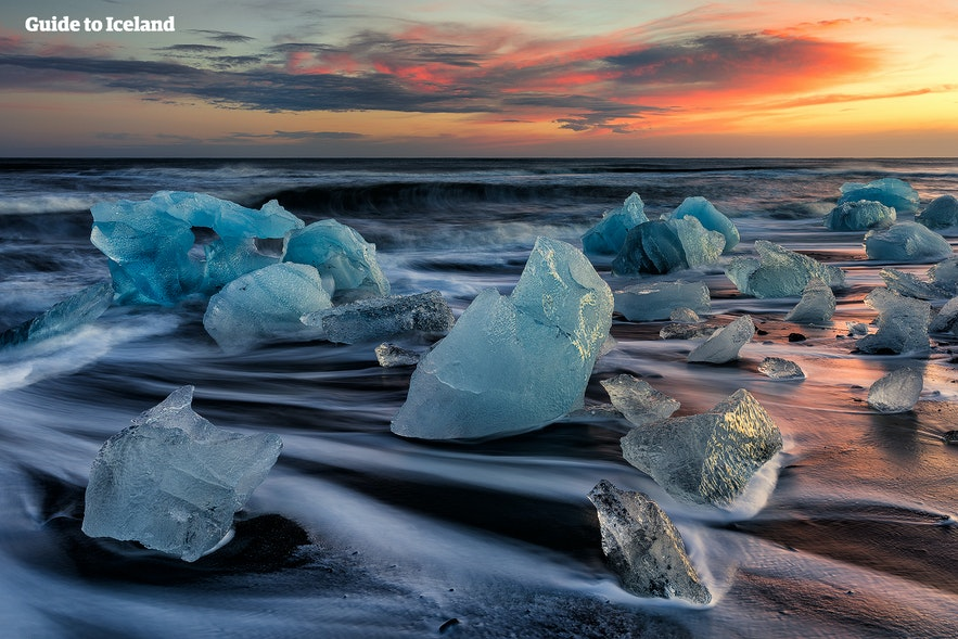 The Diamond Beach in Iceland is littered in blue icebergs.