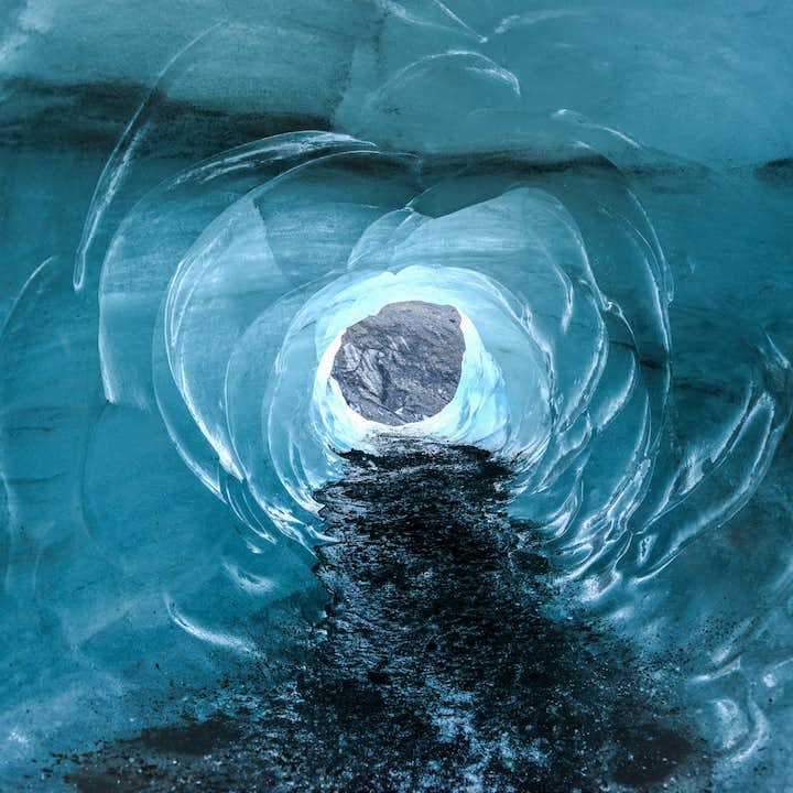Stepping into an ice cave of Vatnajökull in Iceland is like entering another world.