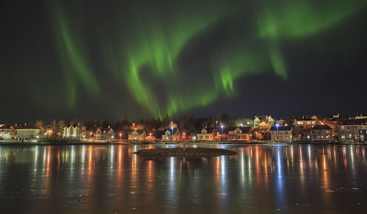 Northern Lights over the city pond in Reykjavík