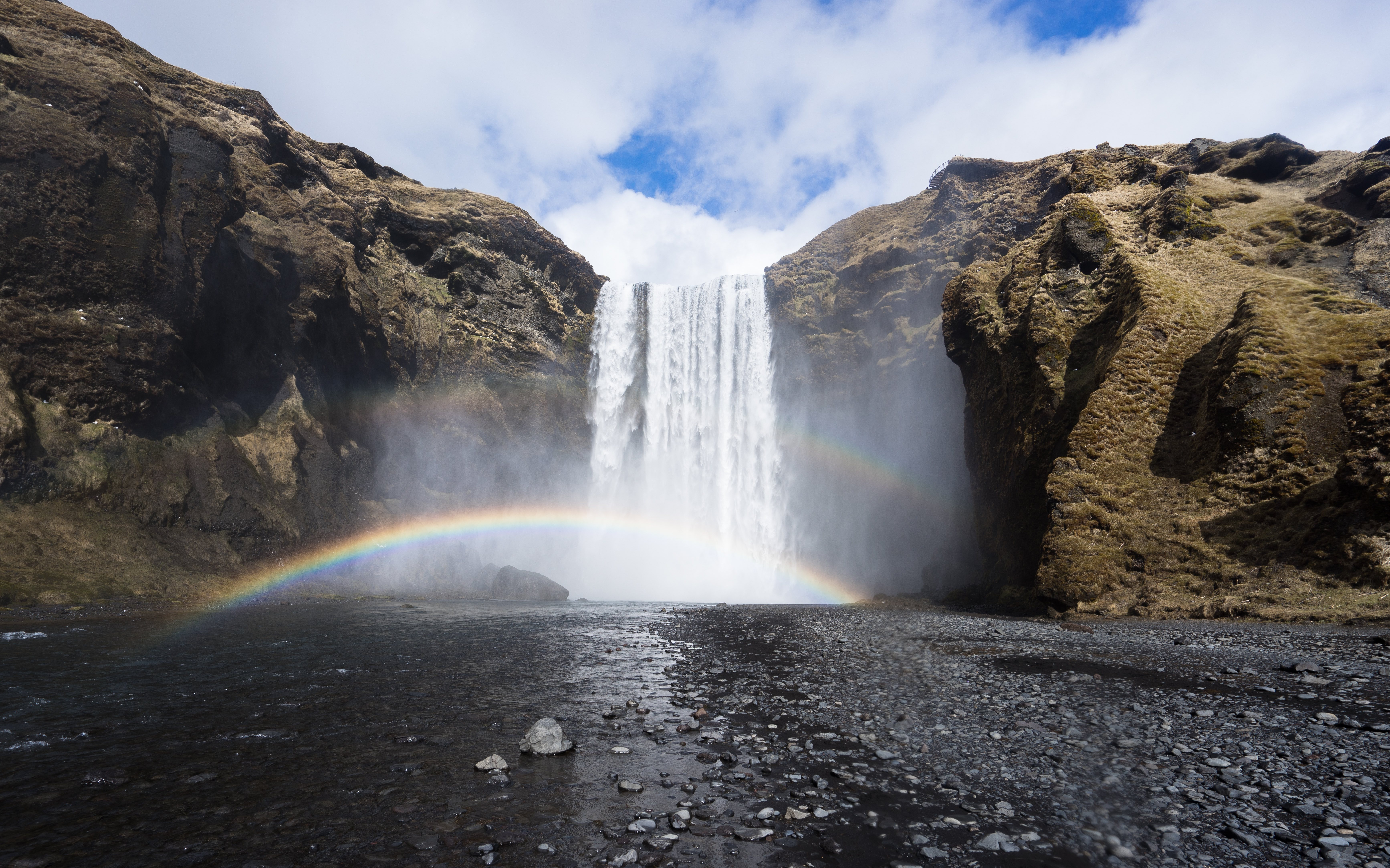 A rainbow formed by the sun and the spray from the mighty Skógafoss waterfall.