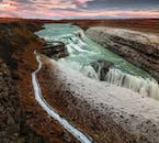 Gullfoss falls in two great tiers into an ancient canyon below.