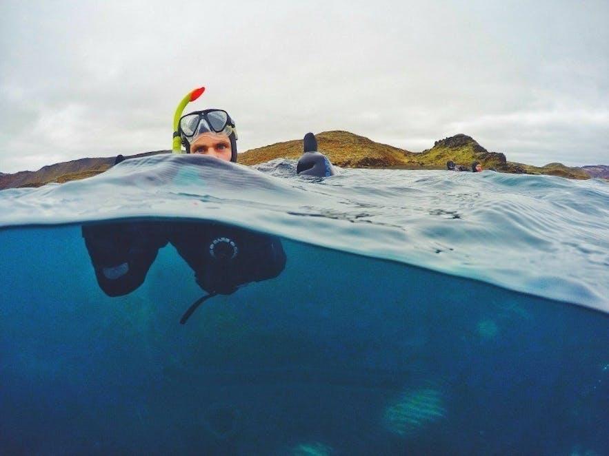 Snorkeling in Kleifarvatn lake, Iceland