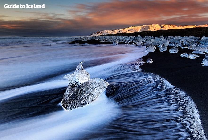 Jokulsarlon flows out onto the black sand Diamond Beach.
