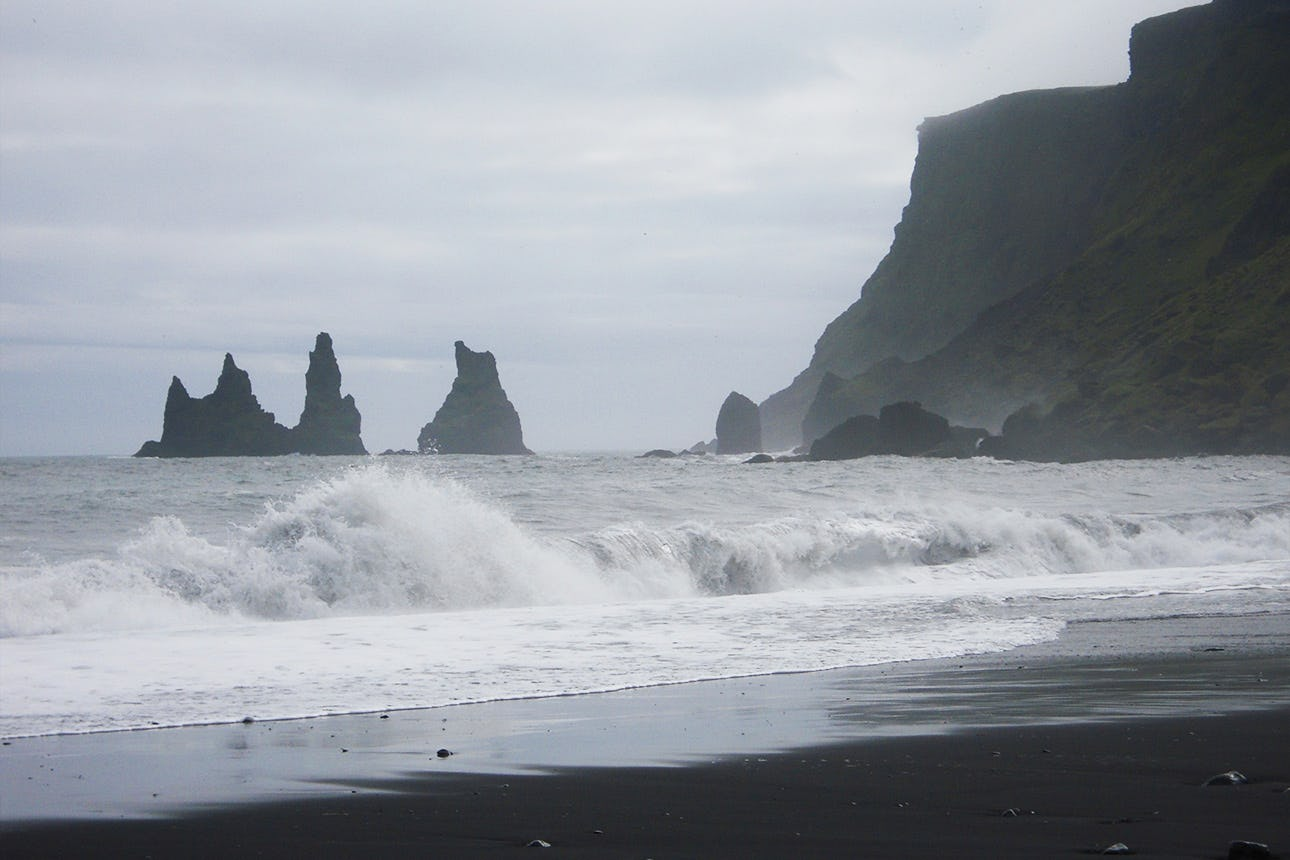 Reynisfjara black sand beach is one of Iceland's most dramatic locations.