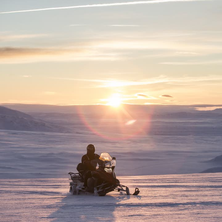 Hop on a snowmobile and start your journey across the glacier.