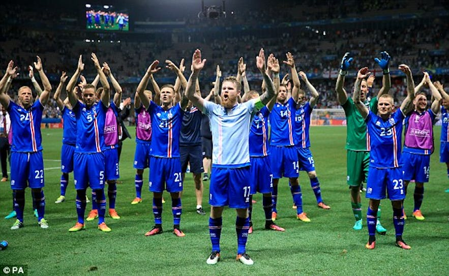 Icelandic team celebrates with Viking chant and their fans