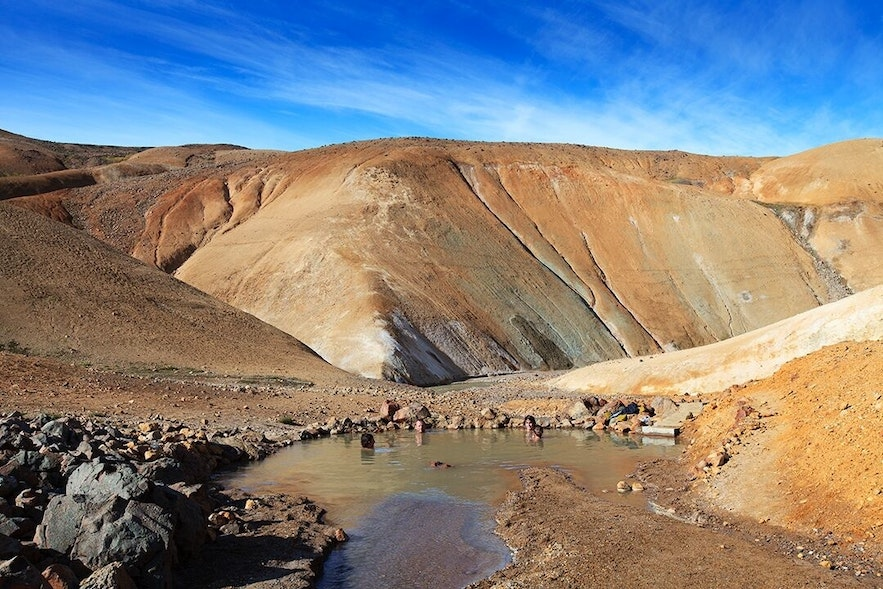 The geothermal area of Hveradalir is known for its vibrant colours and warm pools.