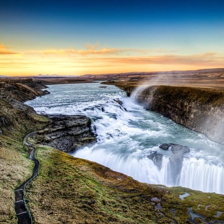 The magnificent Gullfoss waterfall crashes into the canyon below.
