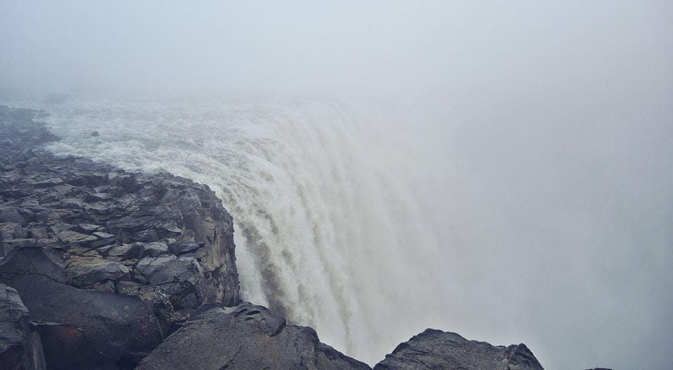 Foggy Dettifoss waterfall in Iceland in June