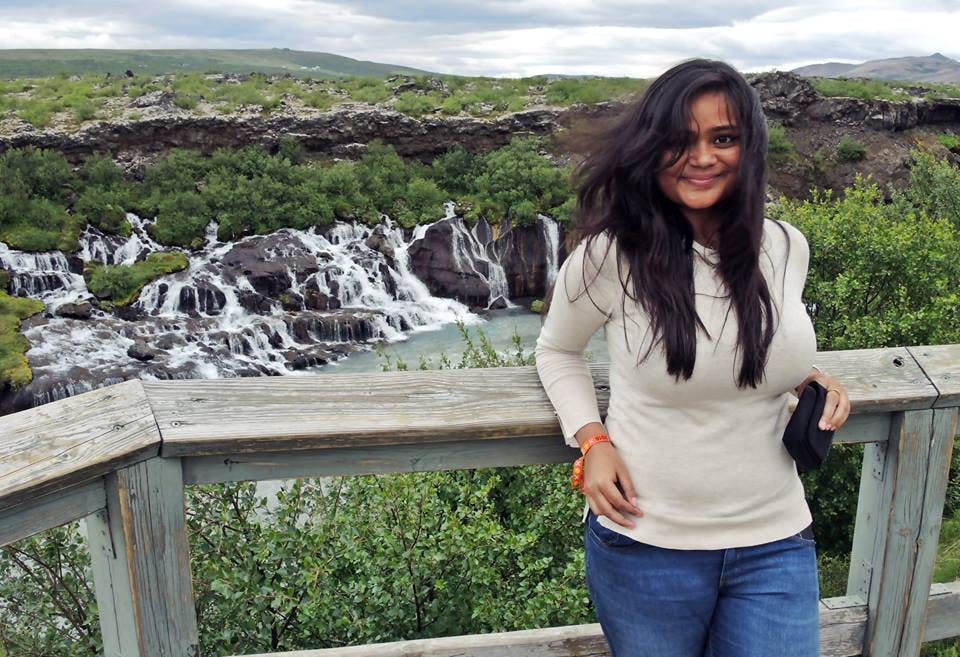 Arunima Ghosh by Hraunfossar waterfalls in Iceland in June