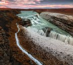 Gullfoss waterfall, in south Iceland, becomes surrounded with a sprinkling of snow in early winter; when the season ends, it will be piled under metres of it.