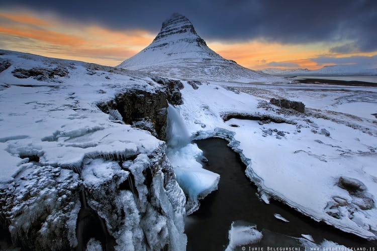 Wrapped in snow and ice, features of the Snæfellsnes Peninsula such as Kirkjufell and Kirkjufellsfoss develop a more dramatic form of beauty.