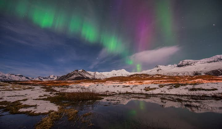 Travel in Iceland during winter time and witness the northern lights dancing in the sky above you.
