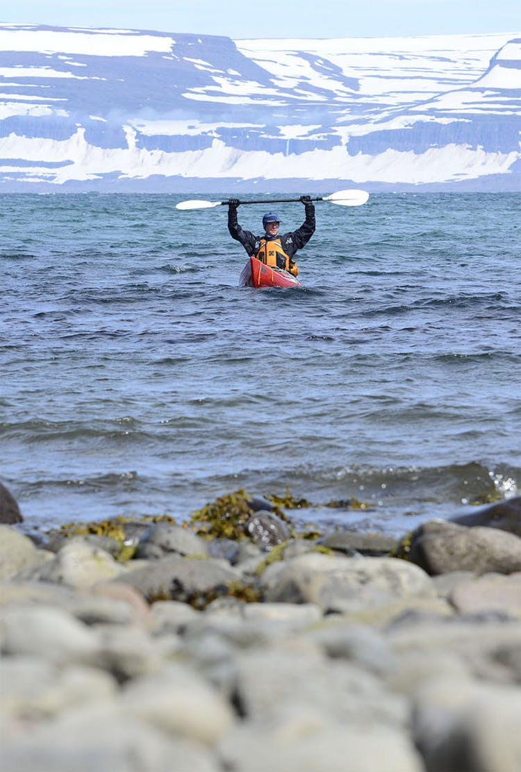 Enjoy the sense of victory that comes after a long kayaking experience in the Westfjords, when you reach a new, beautiful spot in the Hornstrandir Nature Reserve.