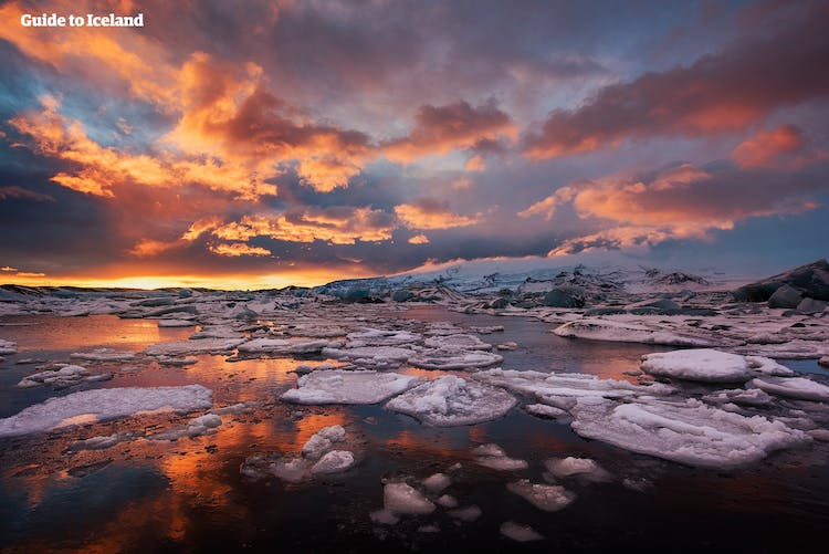 In the midnight sun, the skies above Jökulsárlón become dyed magical colours, that reflect on the ice.