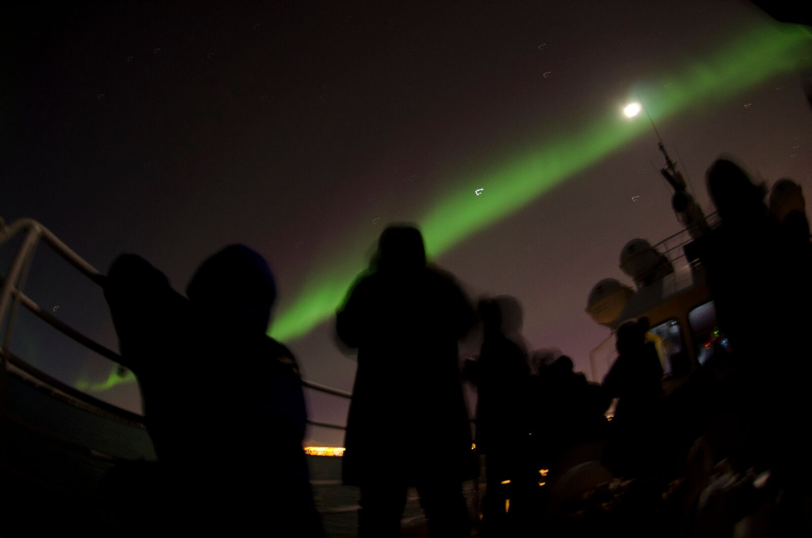 Seeing the Northern Lights by boat allows guests to totally avoid the city's light pollution.