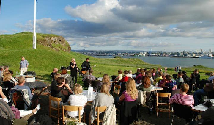 A group gather for a concert on Viðey Island.