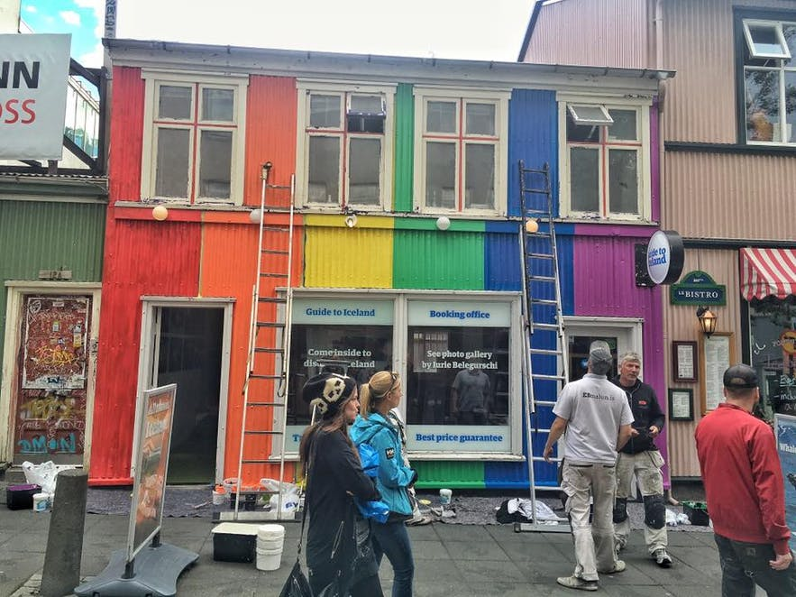 Painters working on the new rainbow look of Guide to Iceland's office