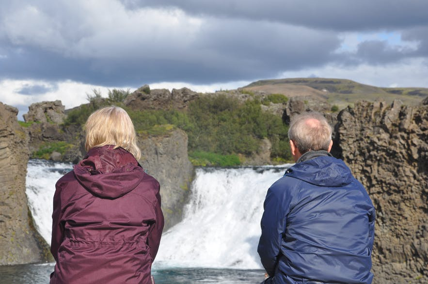 Admiring the Hjálp waterfall in Iceland