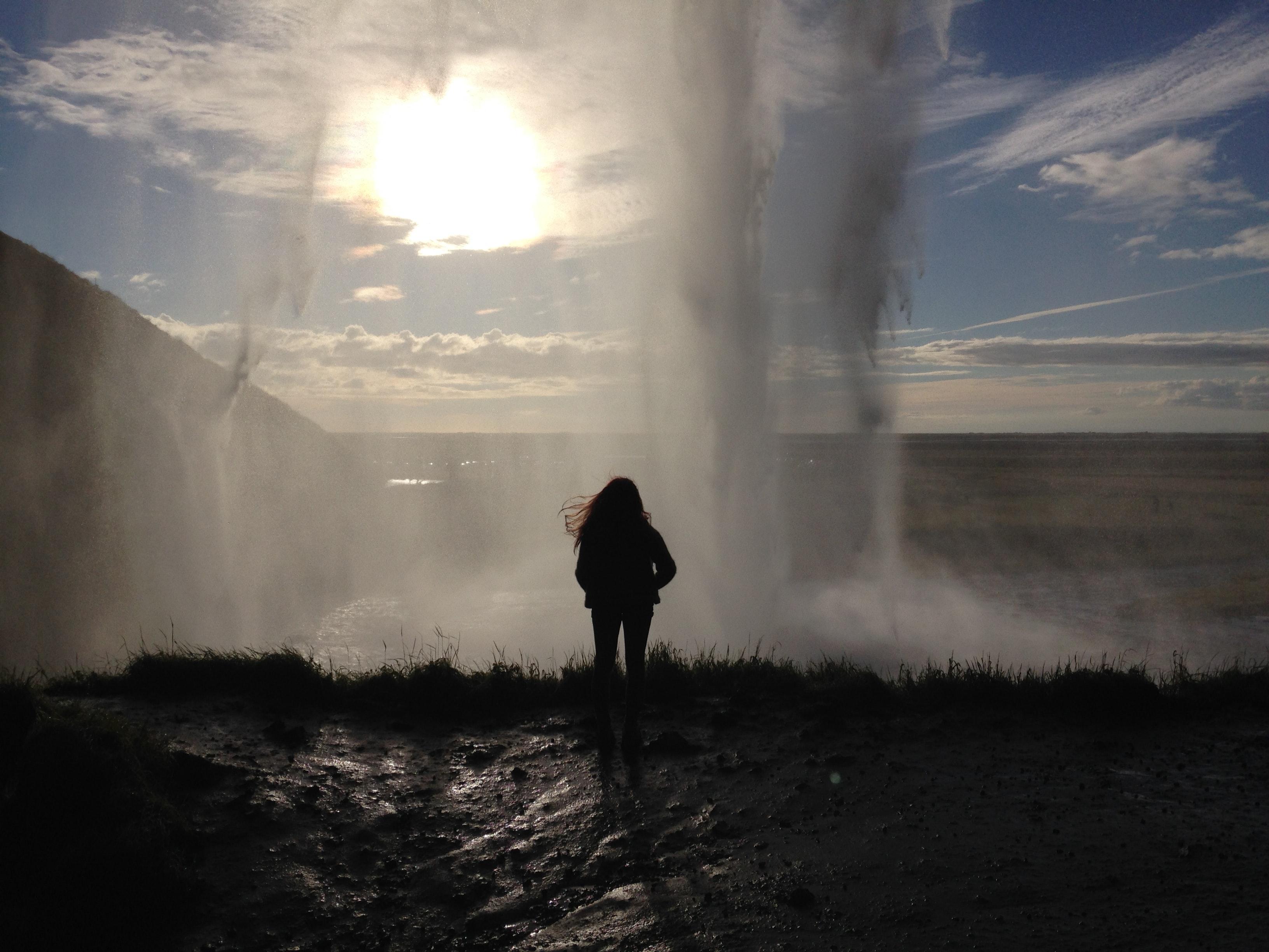 Standing behind Seljalandsfoss waterfall in Iceland