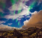 Like some ethereal forces from heaven, the Northern Lights plunge in the sky above west Iceland.