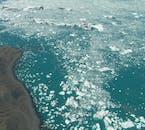 Bestaune die Gletscherlagune Jökulsárlón bei einem Rundflug ab Skaftafell.