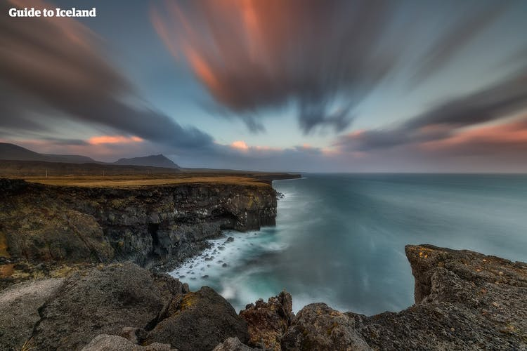 The Gerðuberg cliffs on the coastline of the Snæfellsnes Peninsula provide a dramatic and otherworldly scenery.