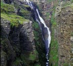 Rather than cascading straight downwards, Glymur's water tumbles and falls clumsily down the mountainside.
