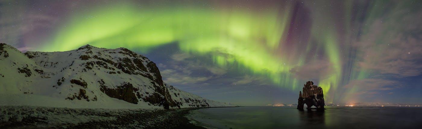 Hvítserkur sea stack with Northern Lights above