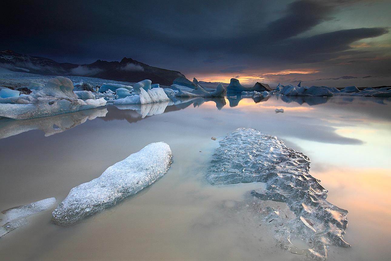 Jökulsárlón glacier lagoon bathed in the soft light of winter's sun.
