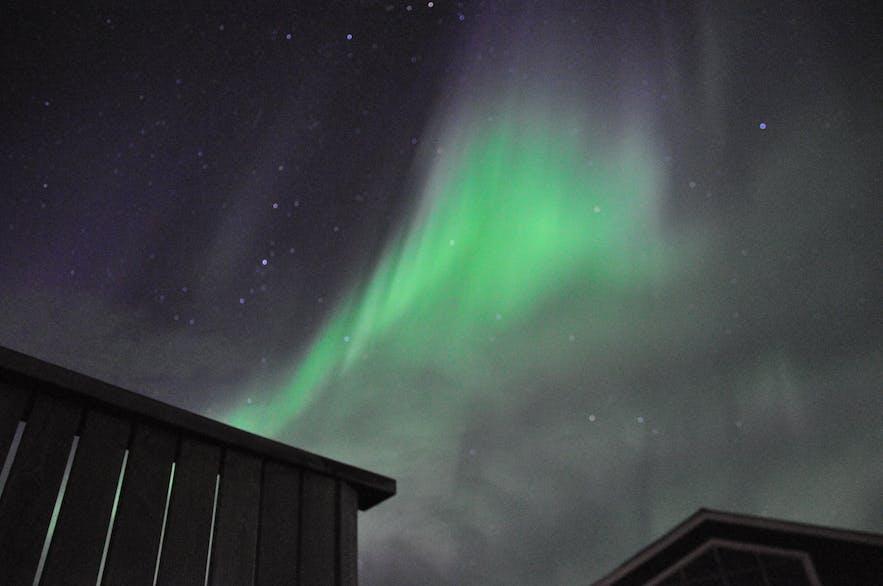 Auroras over Lamb-inn guesthouse by Akureyri