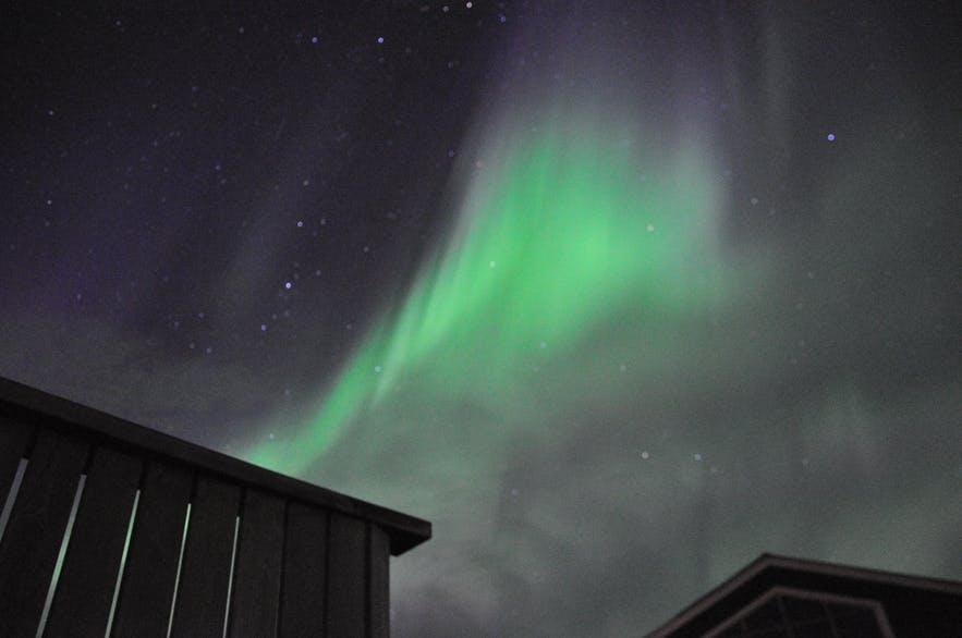 Auroras over Lamb-inn guesthouse by Akureyri