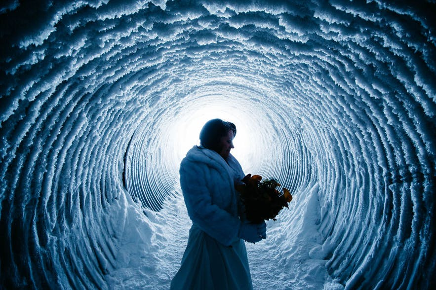 Bride inside a glacier in Iceland. Picture by Kristín María.