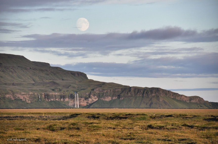 Supermoon over Seljalandsfoss waterfall in south Iceland