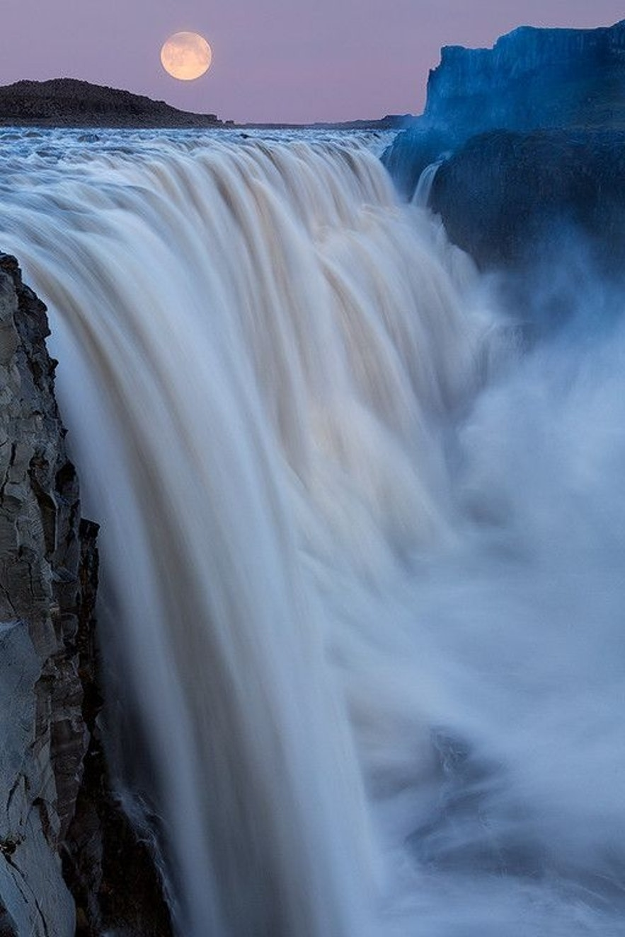 Supermoon over Dettifoss waterfall in north Iceland