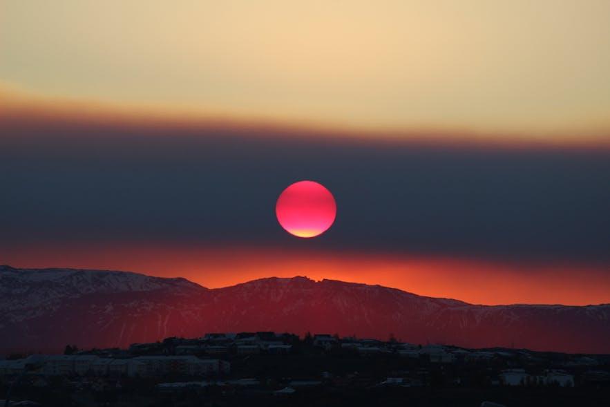 Blood red sun rising over Reykjavík, Óttar Sveinsson