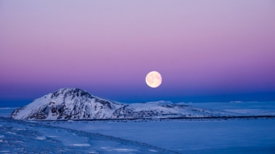 Supermoon over Icelandic winter landscape by Mike Moore